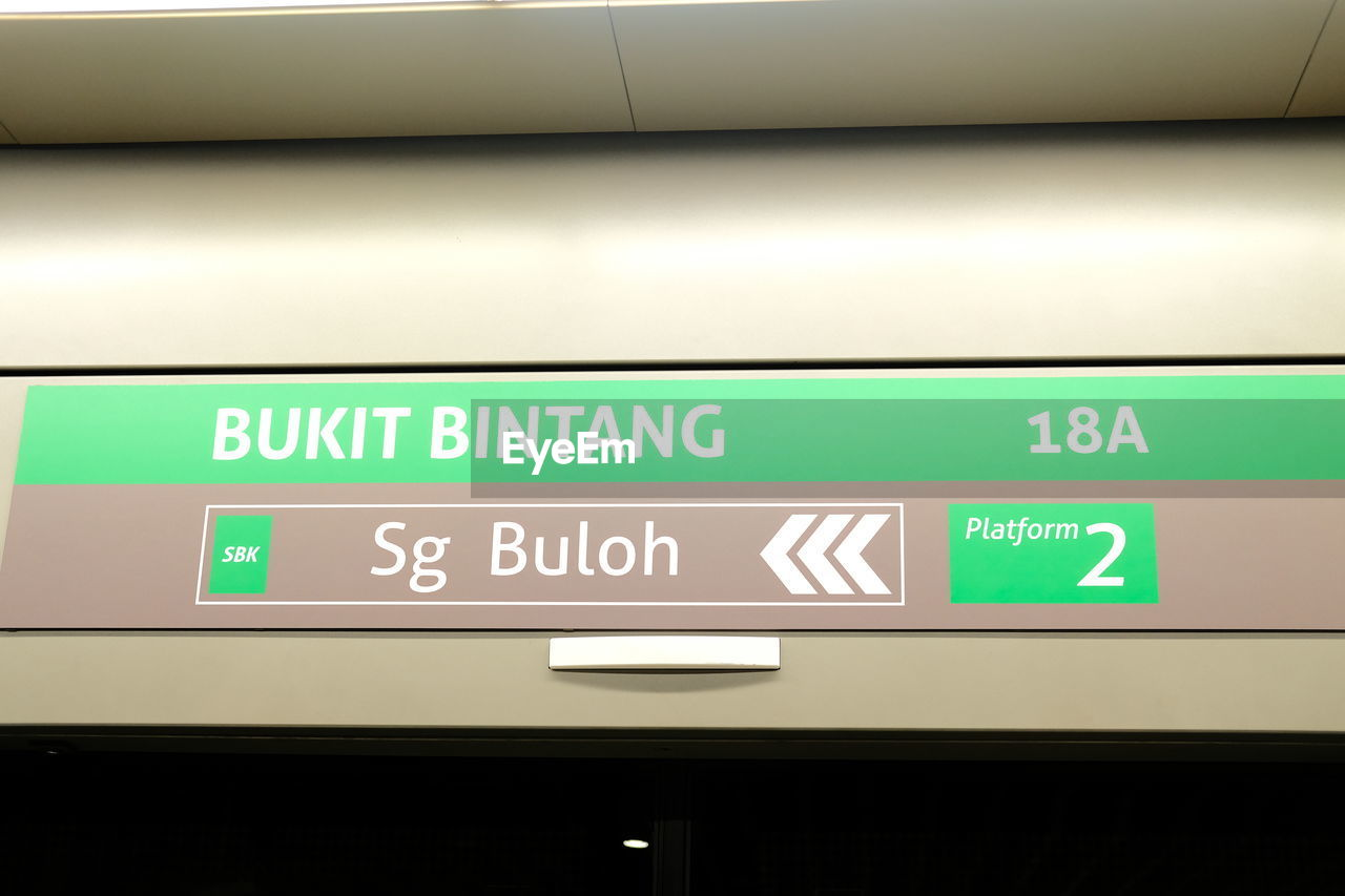 LOW ANGLE VIEW OF TEXT ON AIRPORT