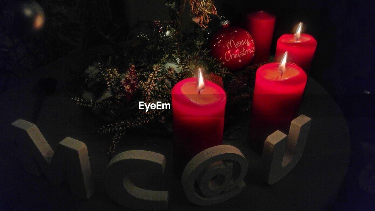 candle, flame, christmas, burning, celebration, indoors, christmas tree, no people, christmas decoration, illuminated, tradition, red, christmas ornament, night, close-up