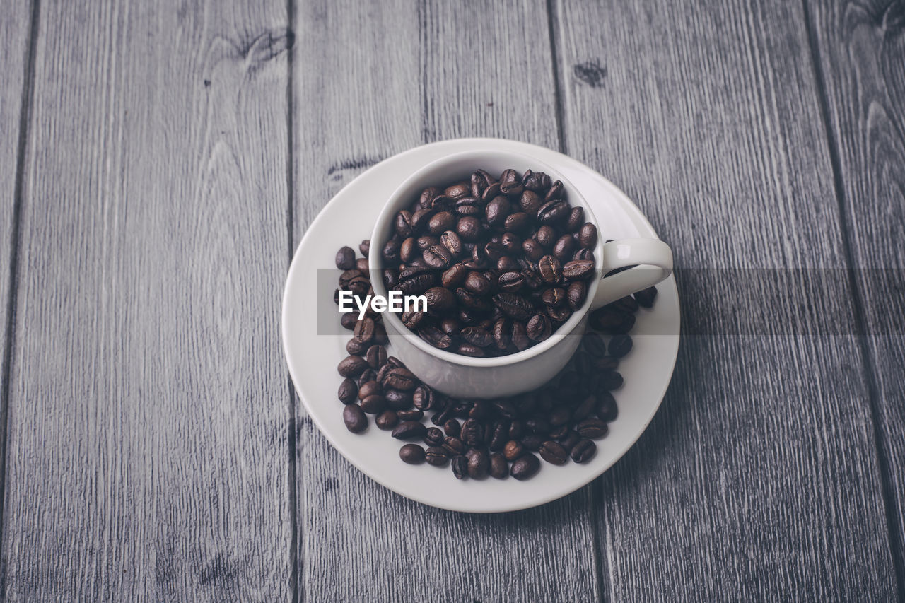 food and drink, table, food, freshness, high angle view, still life, wood - material, bowl, indoors, roasted coffee bean, coffee - drink, coffee, no people, close-up, refreshment, brown, large group of objects, wellbeing, cup, drink, breakfast, crockery, caffeine