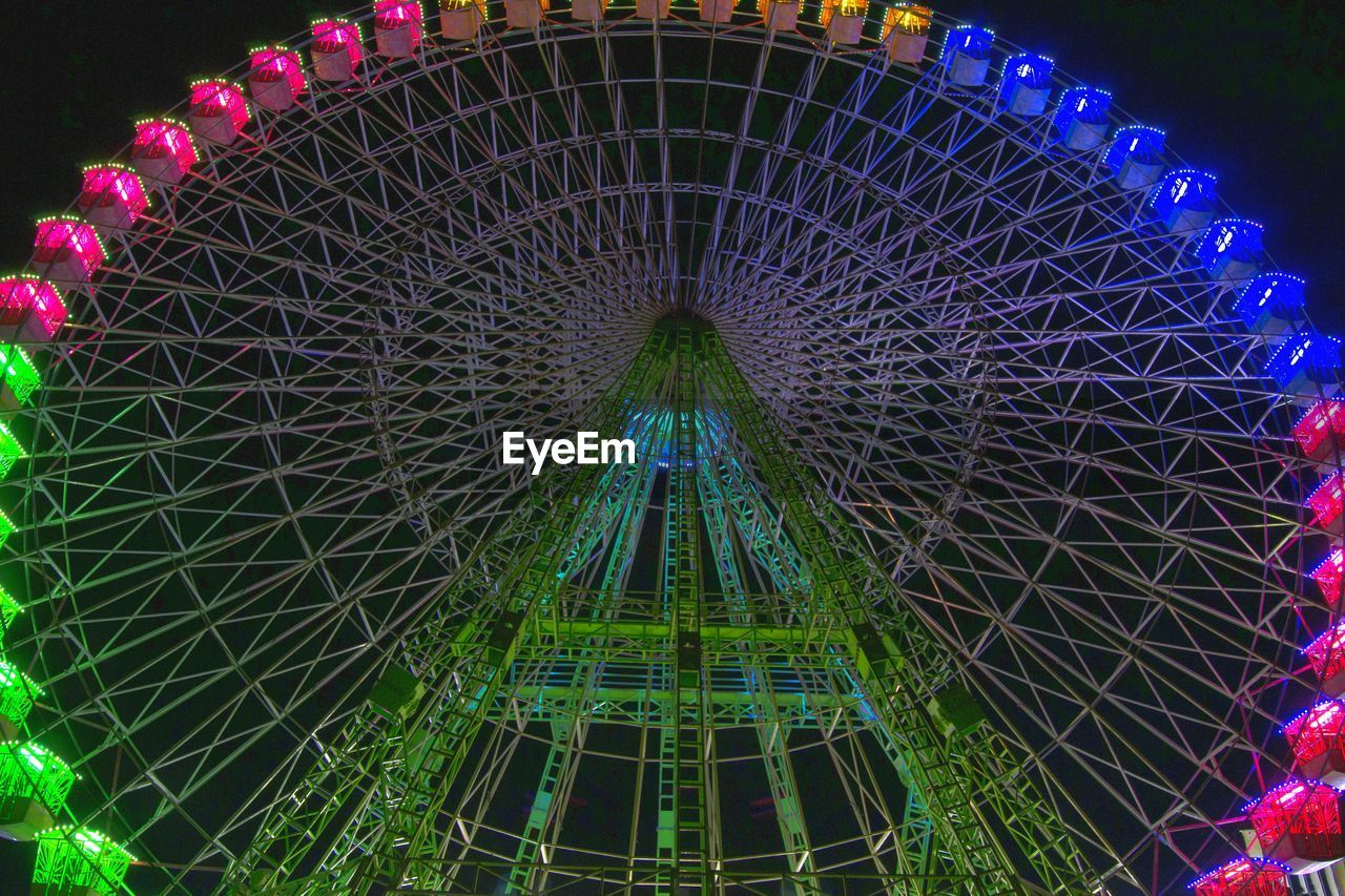 amusement park, night, arts culture and entertainment, illuminated, low angle view, no people, architecture, built structure, outdoors, amusement park ride, sky