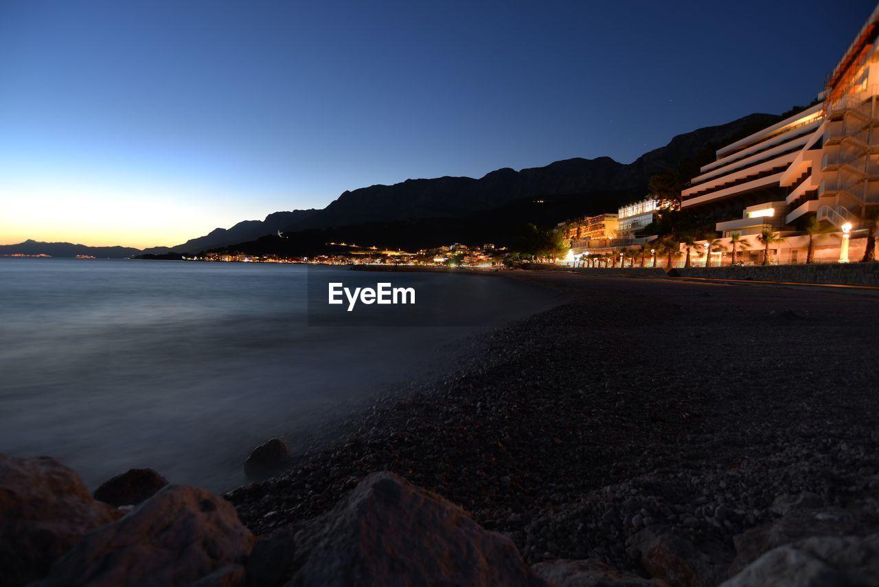 VIEW OF BEACH AT NIGHT