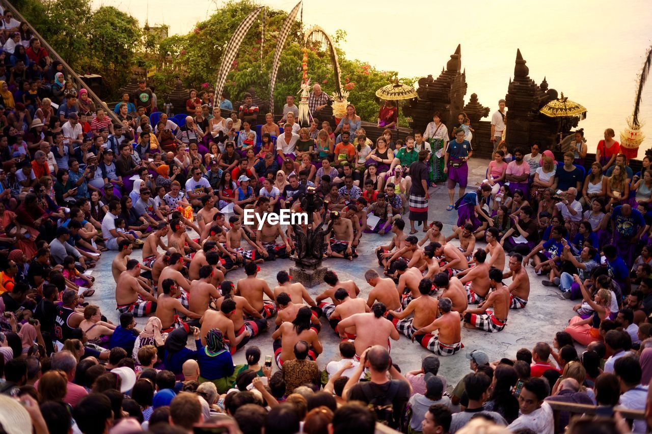 crowd, large group of people, group of people, real people, architecture, women, day, men, high angle view, city, outdoors, street, togetherness, arts culture and entertainment, event, crowded, leisure activity, building exterior, adult, stage