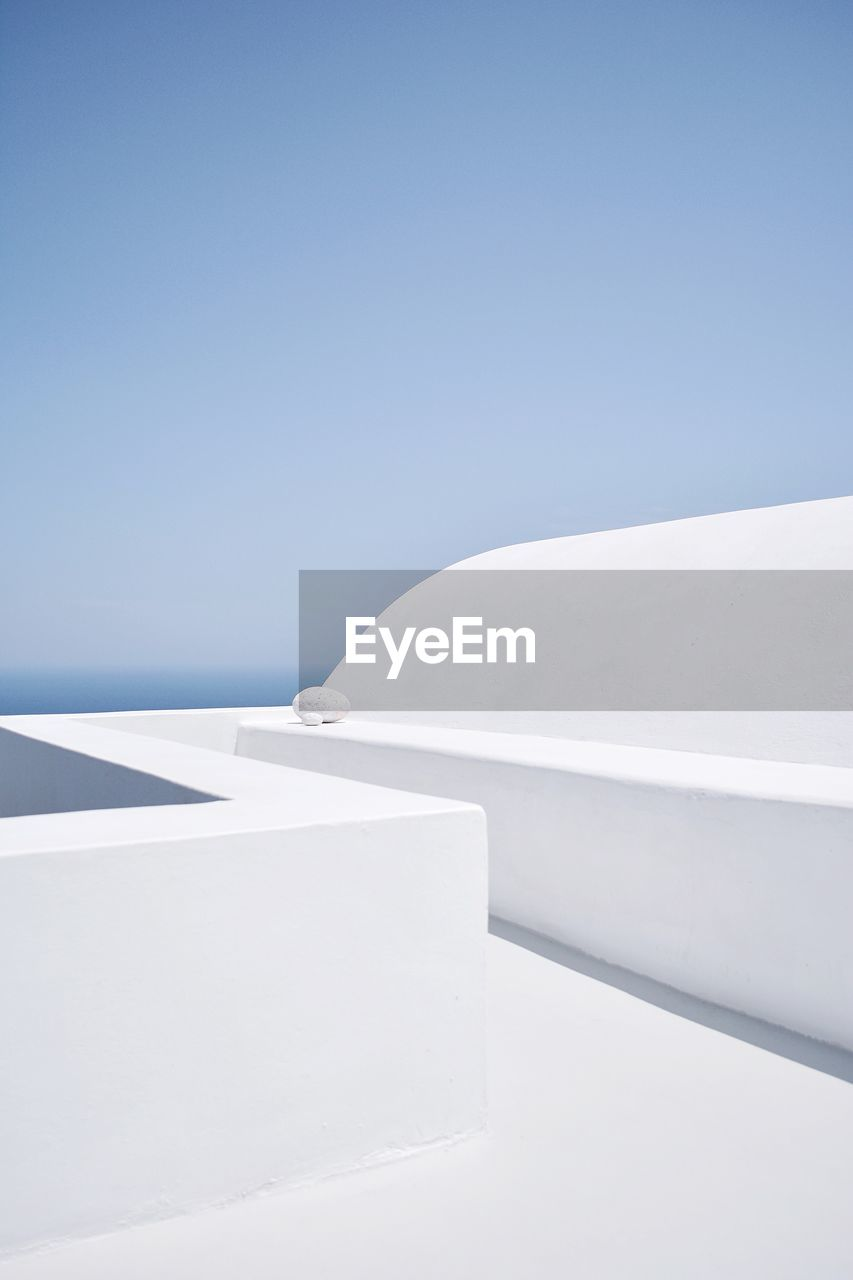 White colored footpath against clear blue sky