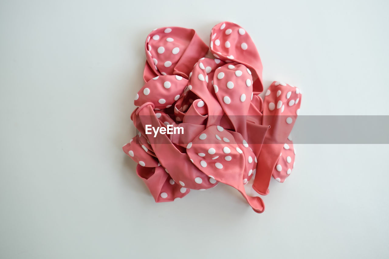 white background, studio shot, indoors, still life, no people, close-up, pink color, red, high angle view, directly above, copy space, cut out, pattern, group of objects, sweet food, art and craft, spotted, shape, medium group of objects, food