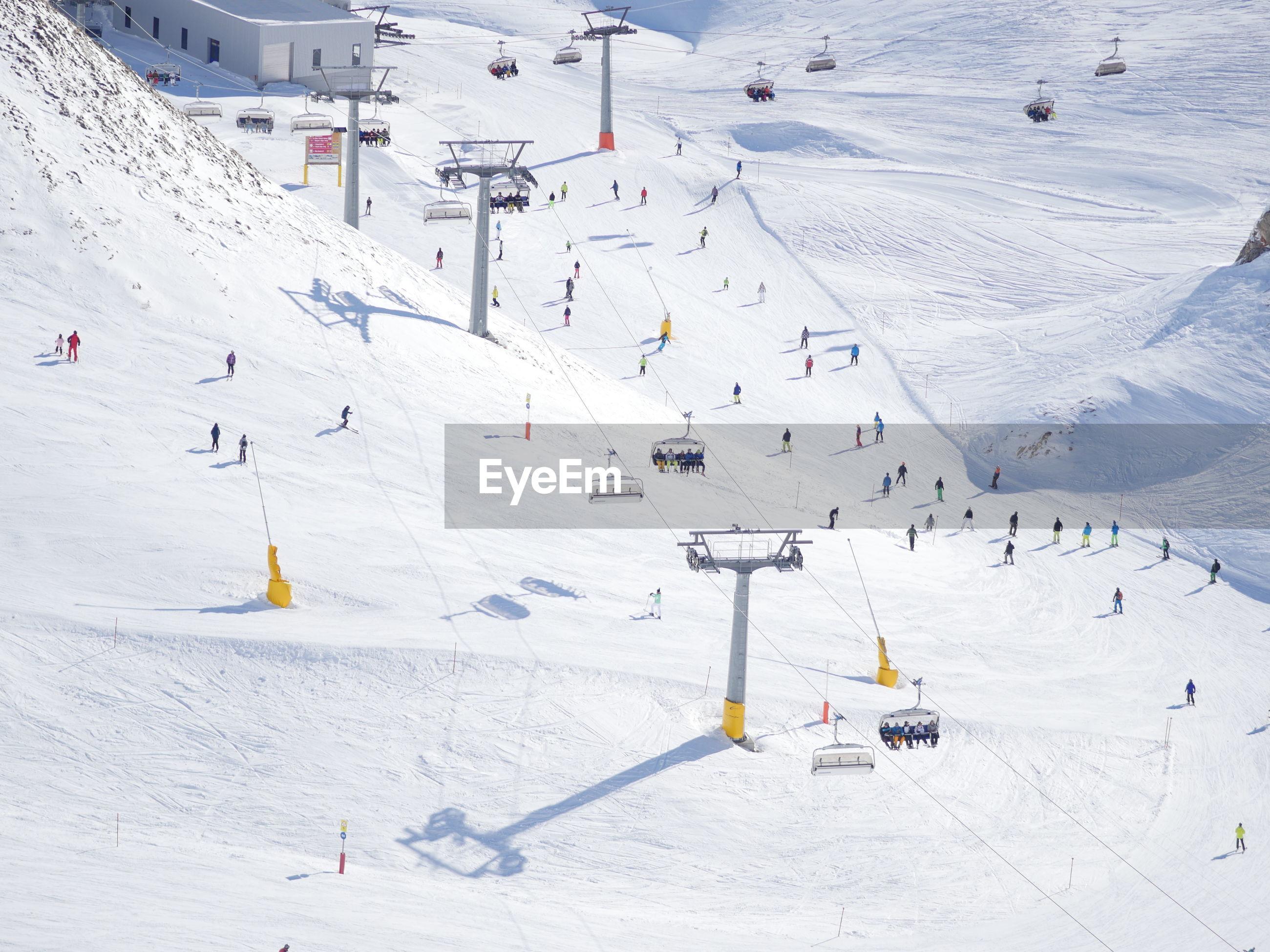 Tourists and ski lifts at ski resort