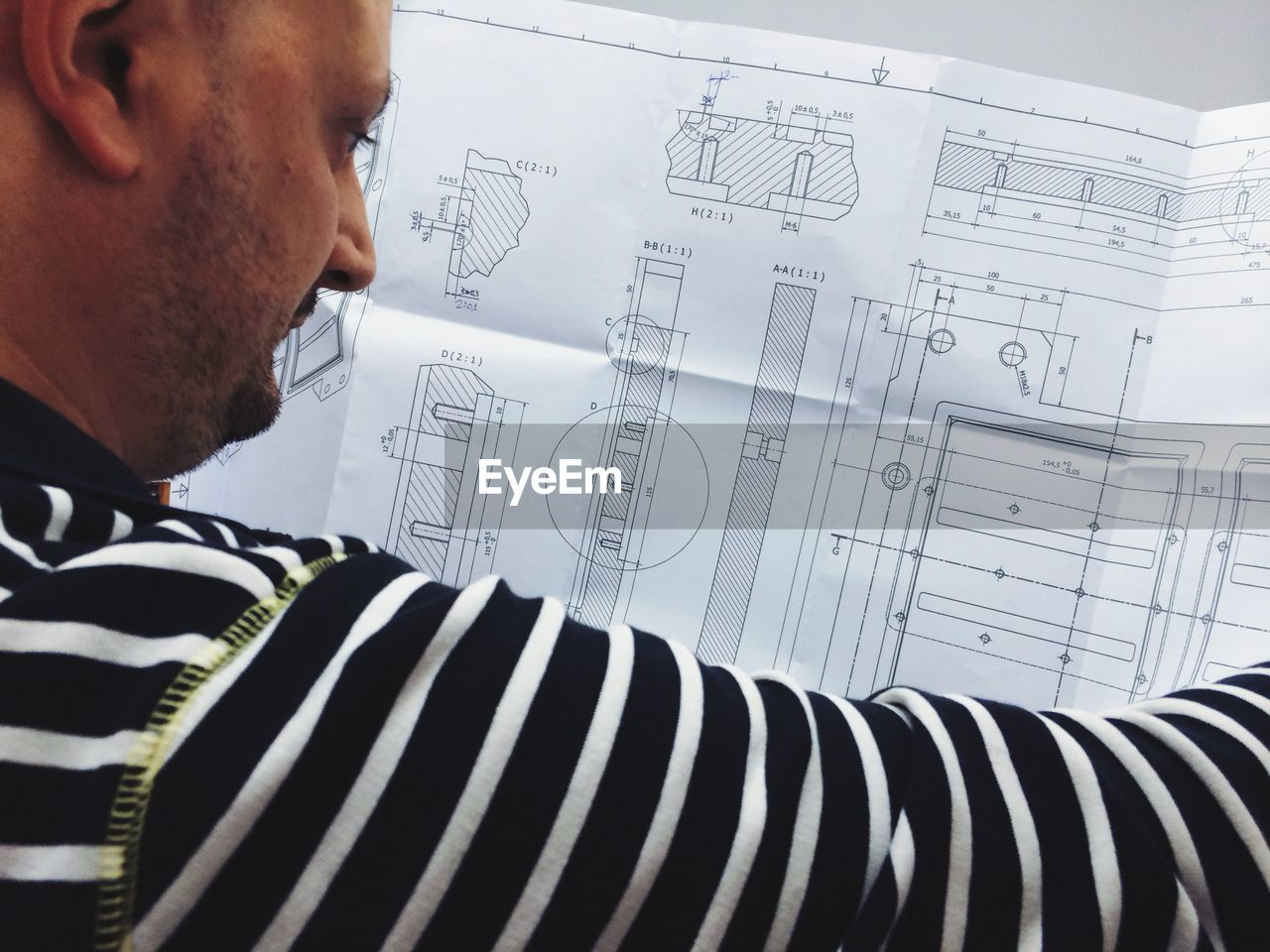 Cropped image of architect analyzing blueprint