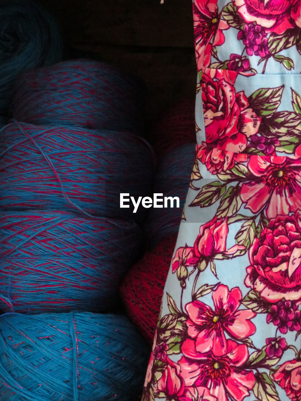 textile, indoors, no people, pattern, high angle view, close-up, multi colored, furniture, still life, pillow, red, wool, floral pattern, clothing, choice, material, pink color, variation, home interior, bed, softness, warm clothing