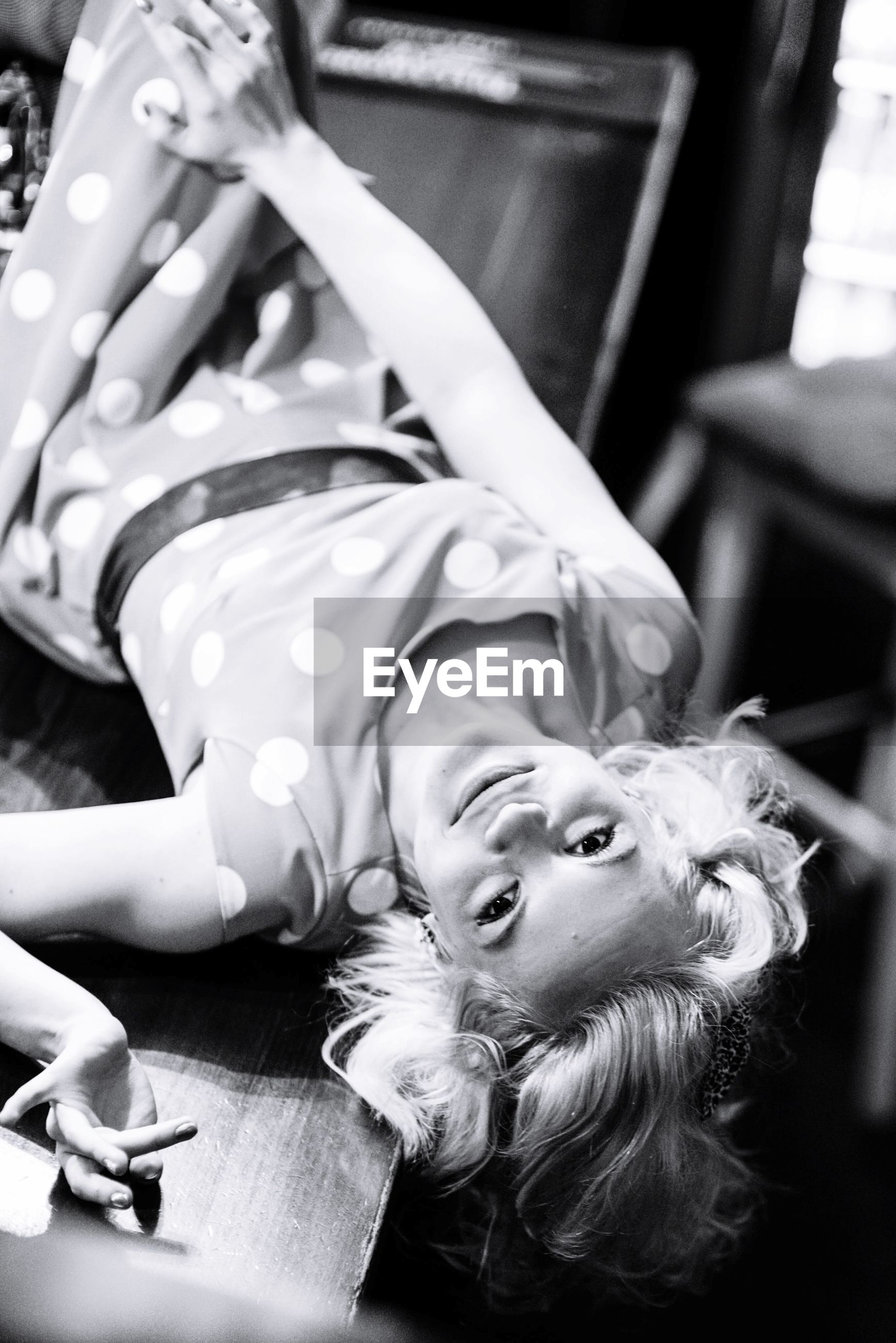 Close-up of young woman lying on floor
