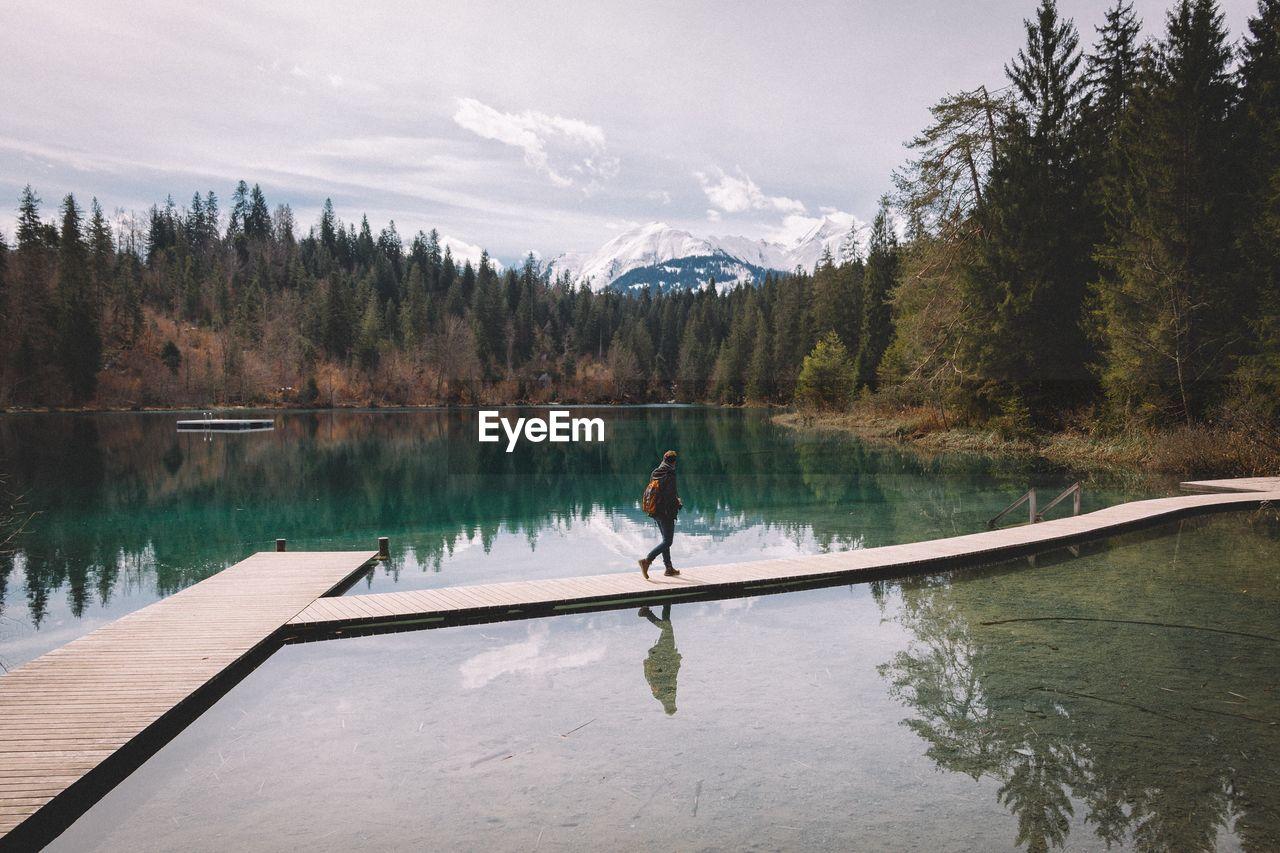 Person Walking On Pier At Caumasee Lake