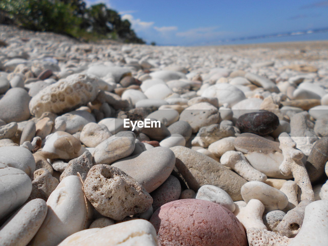 stone, pebble, solid, rock, stone - object, beach, no people, land, nature, day, focus on foreground, rock - object, large group of objects, abundance, sky, beauty in nature, tranquility, close-up, outdoors, tranquil scene, surface level
