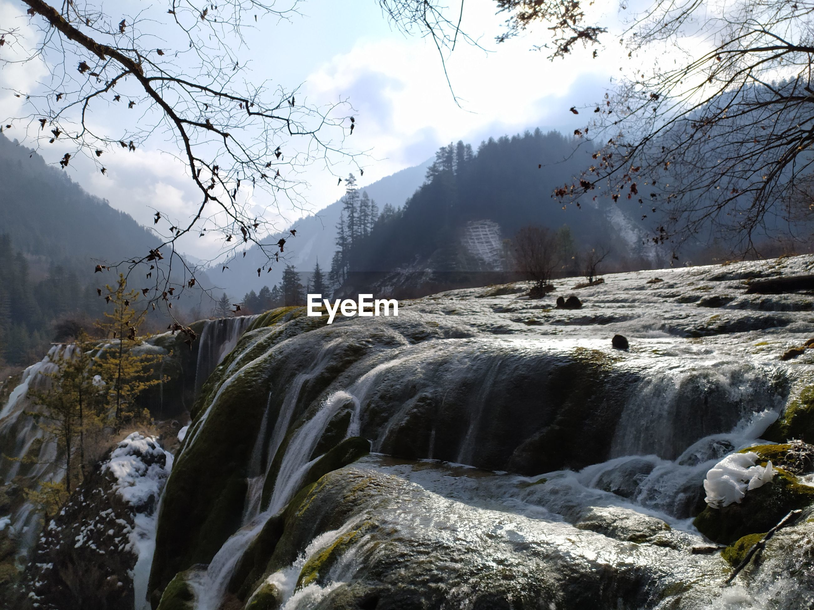 Beautiful view of waterfall in jiuzhaigou national park in china, the heaven on the earth with snow