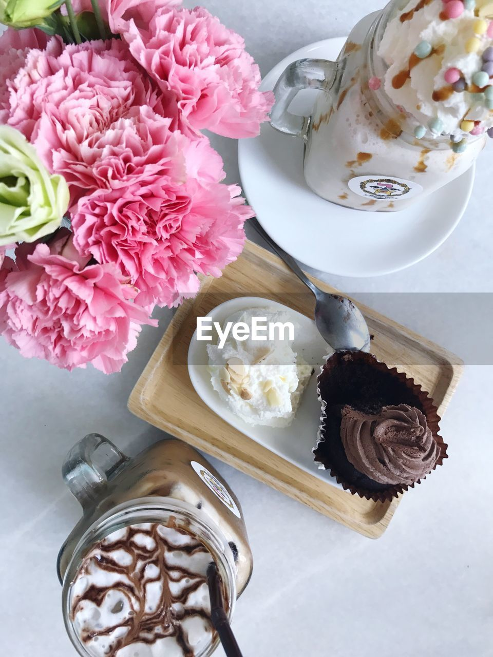 flower, freshness, food and drink, high angle view, no people, sweet food, indulgence, indoors, table, directly above, temptation, food, ready-to-eat, day, close-up