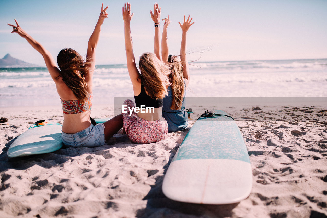 beach, land, sea, sky, water, leisure activity, sand, real people, togetherness, nature, lifestyles, enjoyment, trip, friendship, horizon, holiday, relaxation, vacations, horizon over water, positive emotion, arms raised, human arm, outdoors