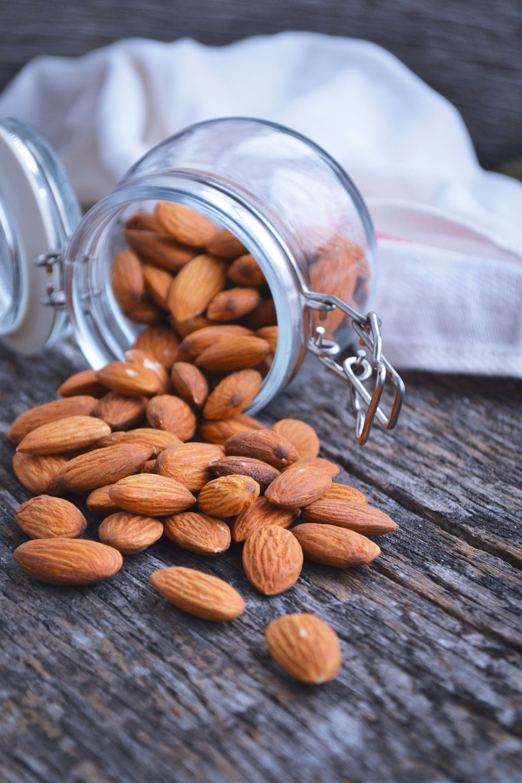 High angle view of almonds in jar on table