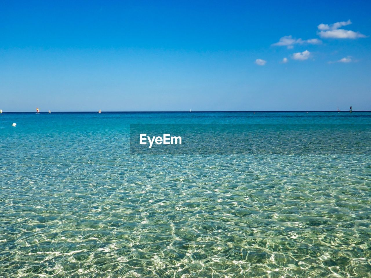 sea, water, sky, beauty in nature, horizon over water, scenics - nature, horizon, blue, tranquility, tranquil scene, nature, day, land, no people, waterfront, clear sky, beach, idyllic, rippled, outdoors, turquoise colored, shallow