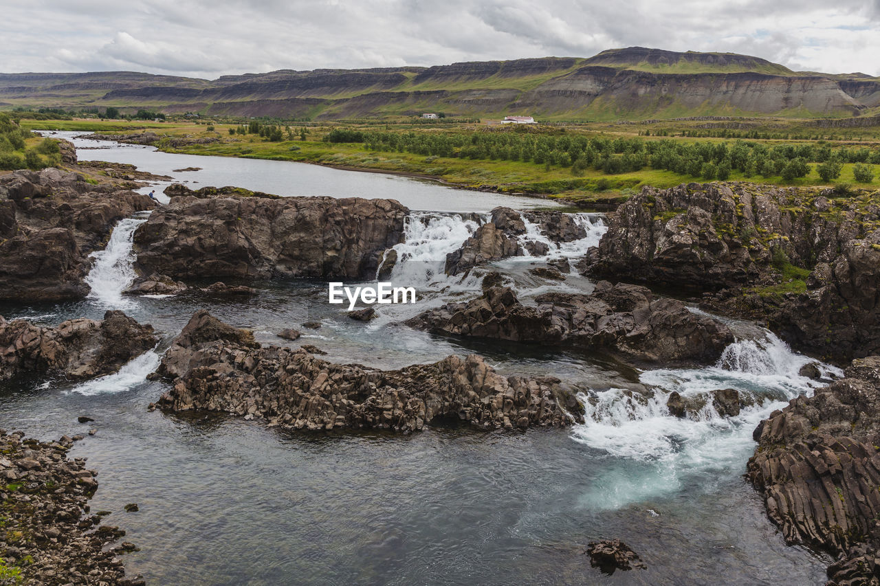 water, scenics - nature, beauty in nature, rock, nature, river, environment, no people, motion, landscape, day, solid, rock - object, land, tranquility, flowing water, tranquil scene, mountain, sky, outdoors, flowing, stream - flowing water