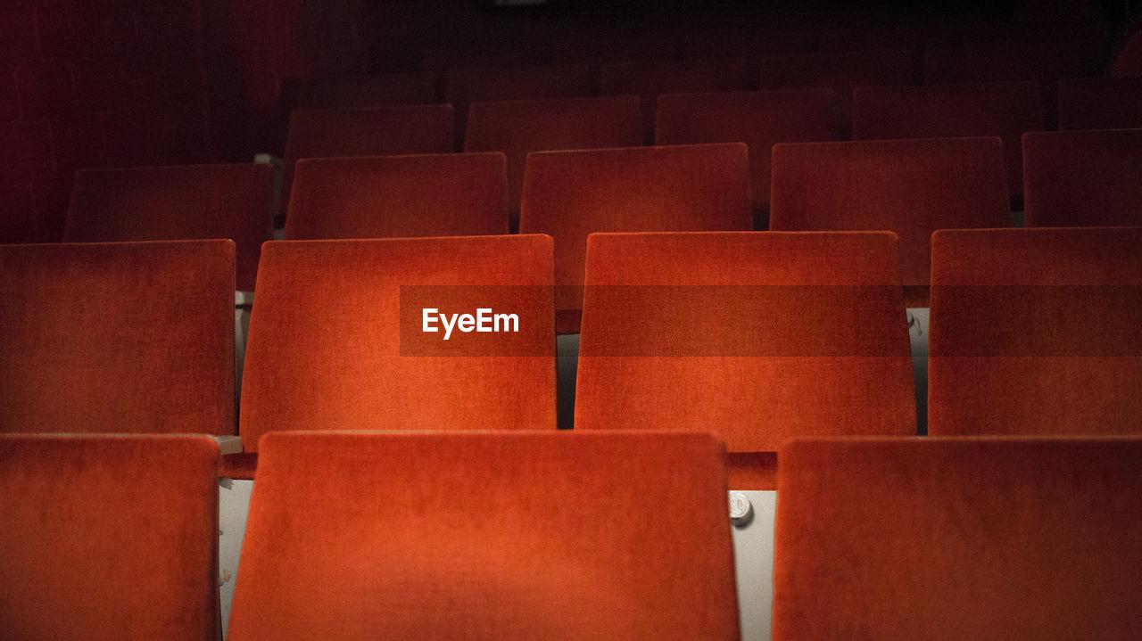 Full Frame Shot Of Empty Seats In Auditorium