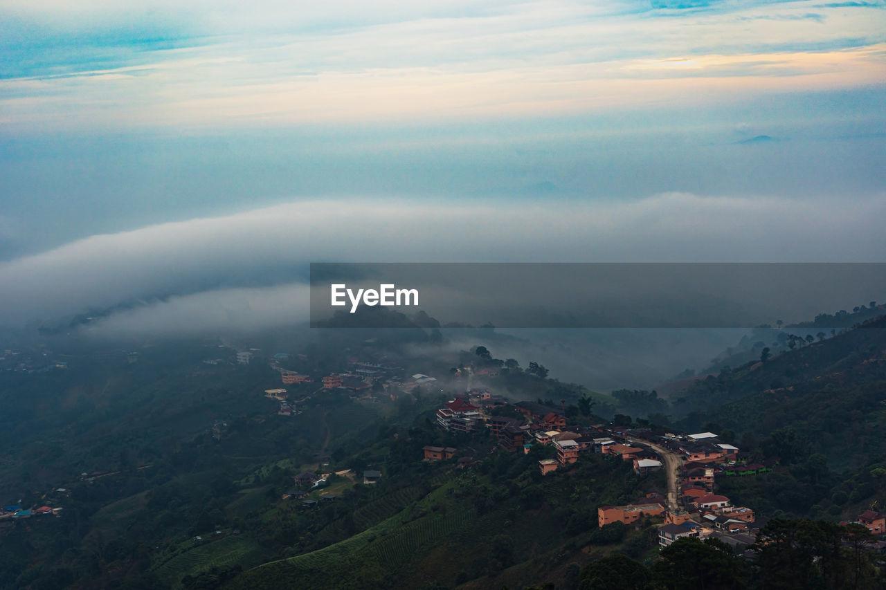Beautiful landscape of mountain layer in morning sun ray and winter fog at mae salong nai, chiangrai