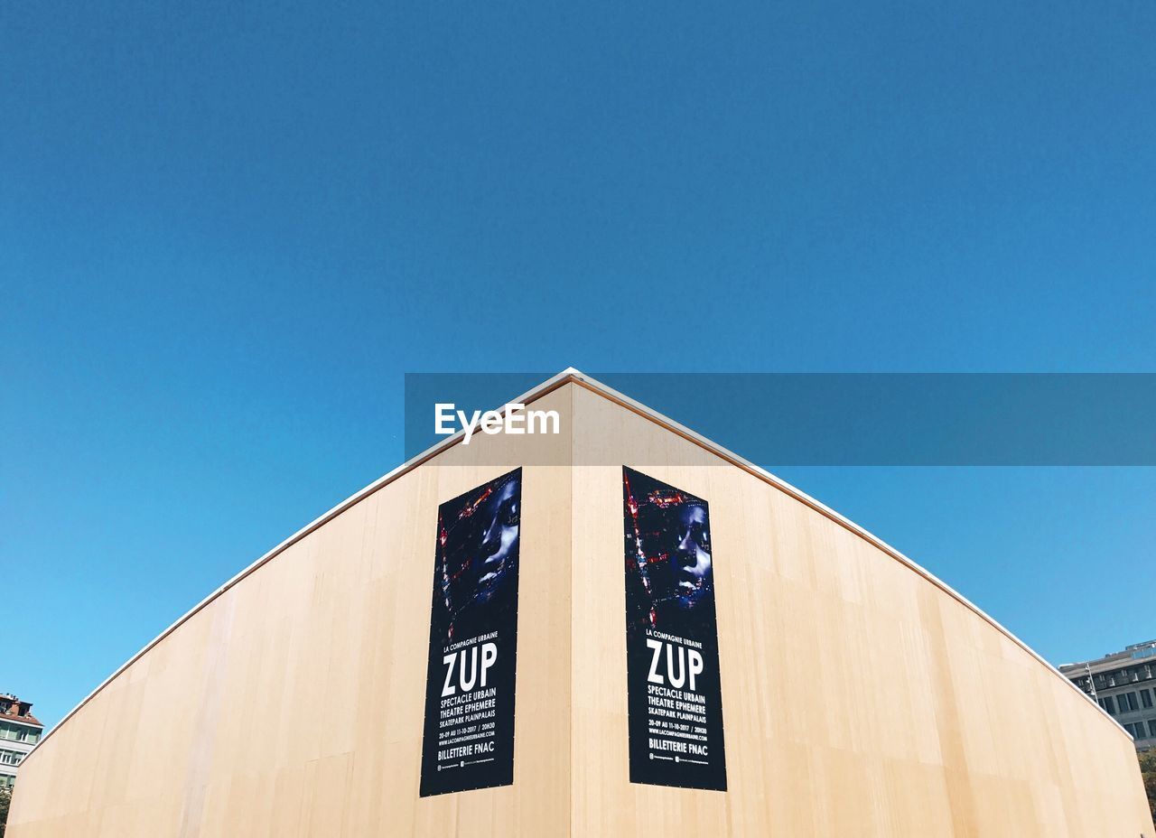low angle view, copy space, clear sky, blue, day, no people, built structure, outdoors, building exterior, architecture, stadium, sky