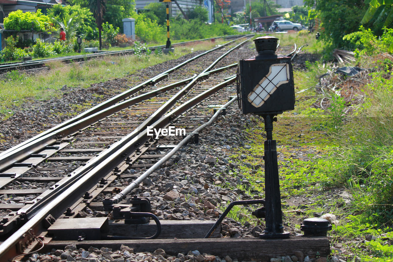 track, railroad track, rail transportation, transportation, mode of transportation, day, plant, nature, no people, public transportation, metal, outdoors, train, focus on foreground, train - vehicle, land, signal, tree, sunlight, direction