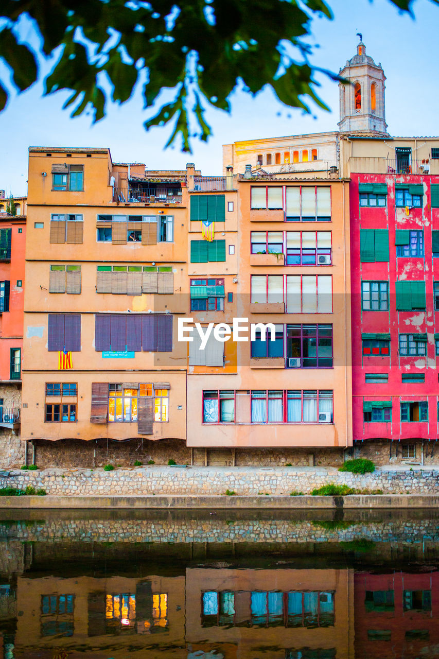 LOW ANGLE VIEW OF MULTI COLORED RESIDENTIAL BUILDING