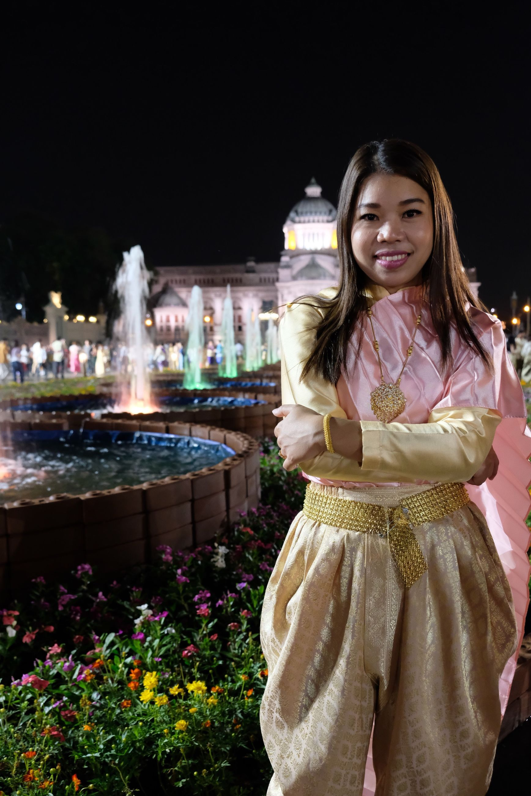Portrait of woman standing in traditional clothing at park during night