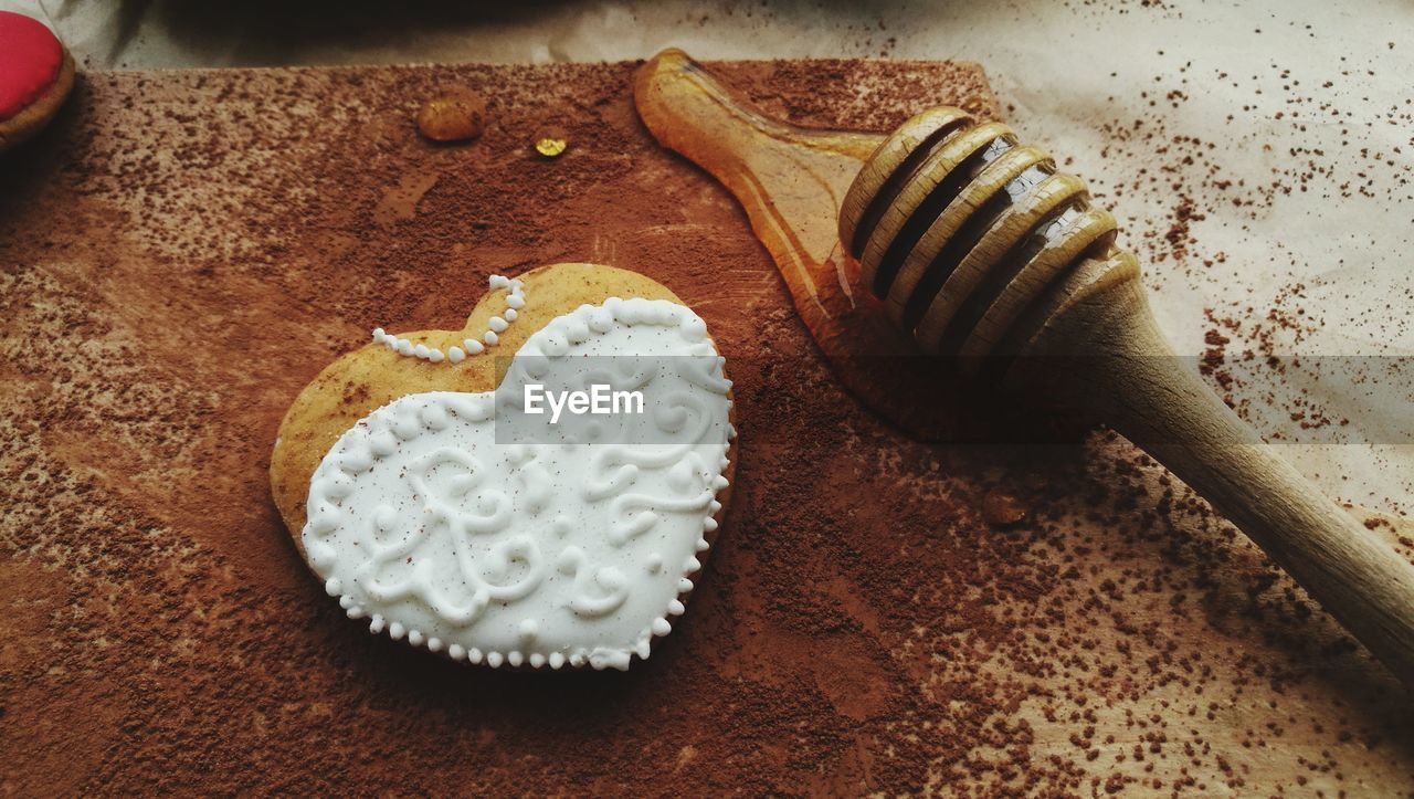 High Angle View Of Cookie And Honey Dipper On Table