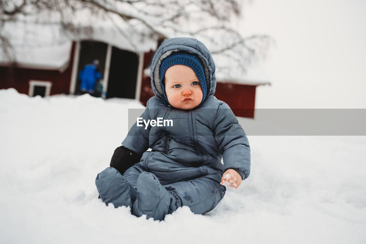 CUTE BOY IN SNOW