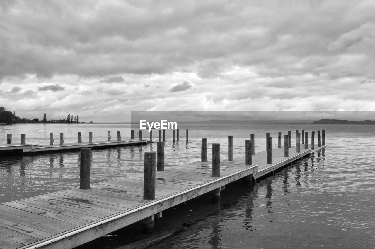 water, sea, cloud - sky, pier, sky, jetty, tranquil scene, tranquility, nature, outdoors, no people, wooden post, day, scenics, beauty in nature, horizon over water