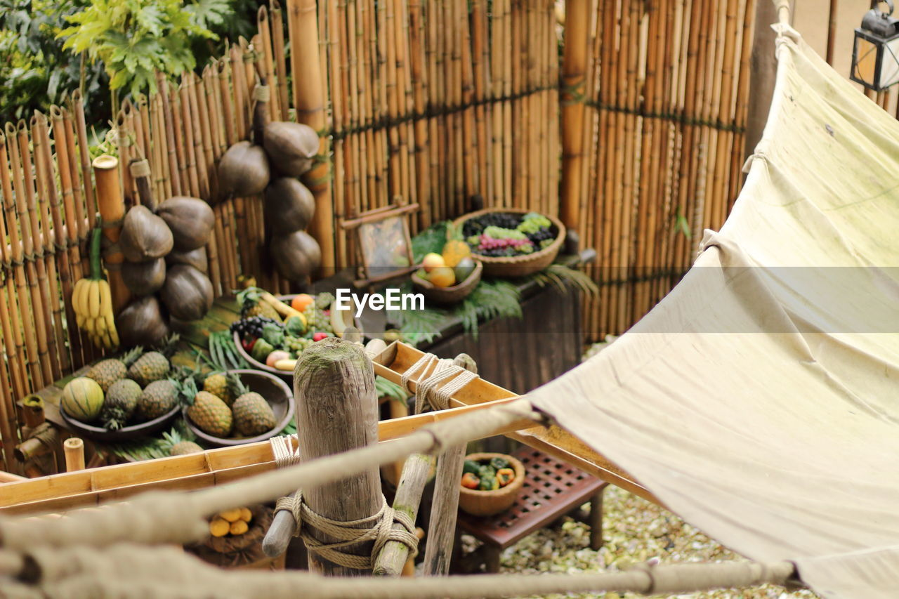 High Angle View Of Food On Tables Against Fence
