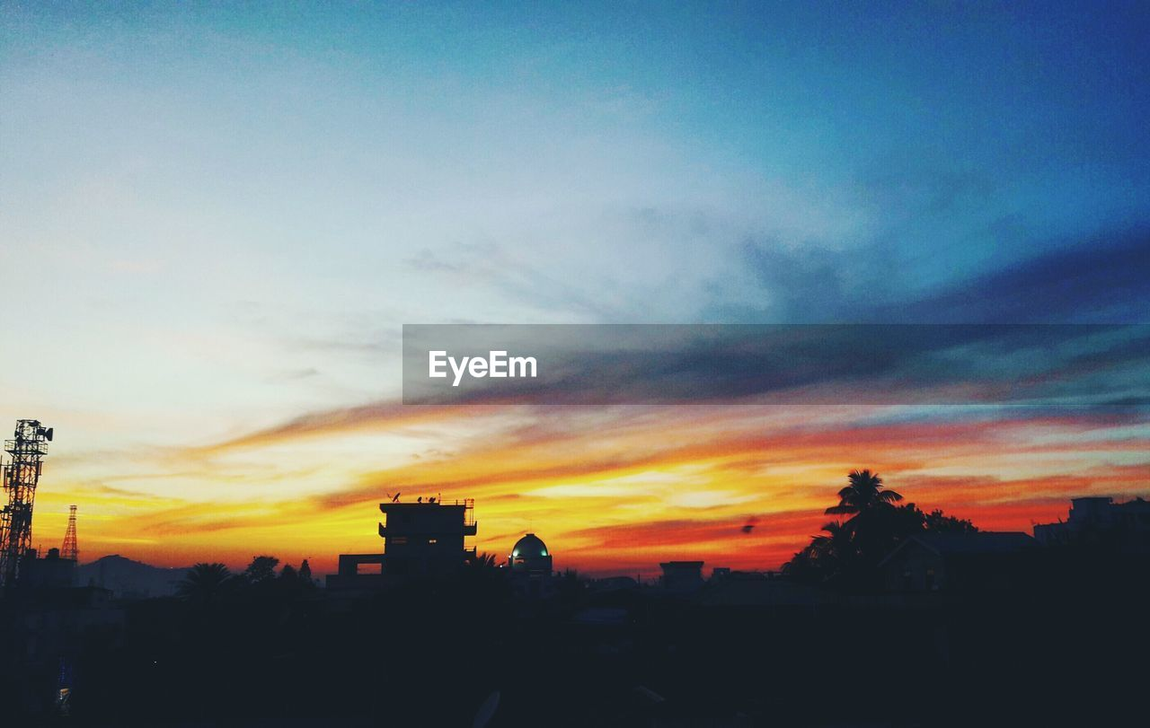sunset, silhouette, building exterior, built structure, sky, architecture, orange color, cloud - sky, outdoors, no people, city, nature, beauty in nature, tree