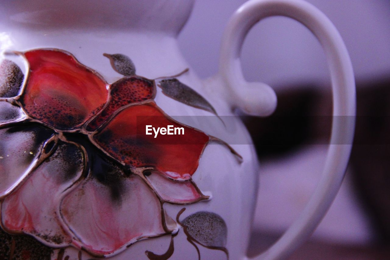 close-up, no people, indoors, focus on foreground, still life, food and drink, food, art and craft, healthy eating, white color, creativity, representation, nature, freshness, container, wellbeing, animal, animal wildlife, animal representation, flower, crockery