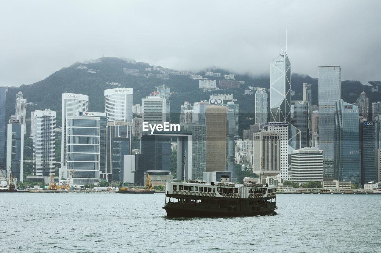 Tour boat against city