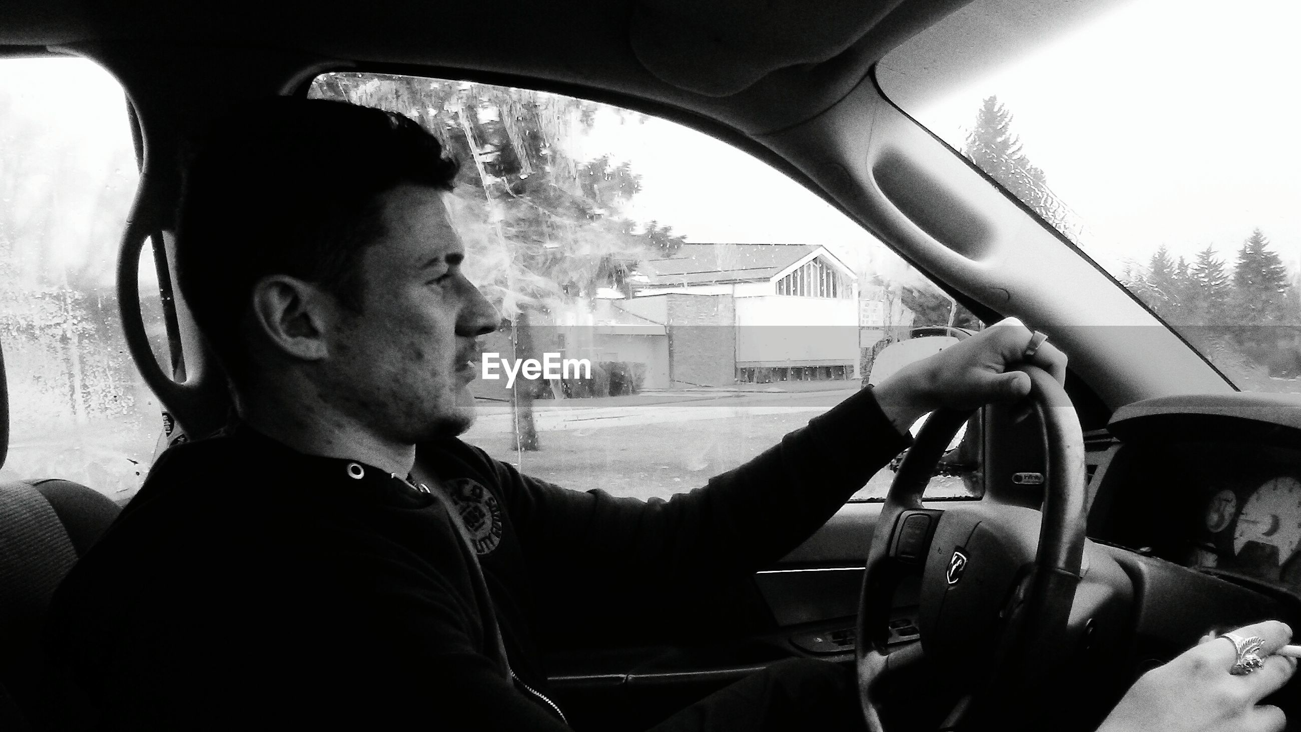car, transportation, car interior, one person, only men, mode of transport, land vehicle, driving, adults only, vehicle interior, one man only, headshot, mature adult, steering wheel, adult, men, people, day, close-up, businessman, indoors