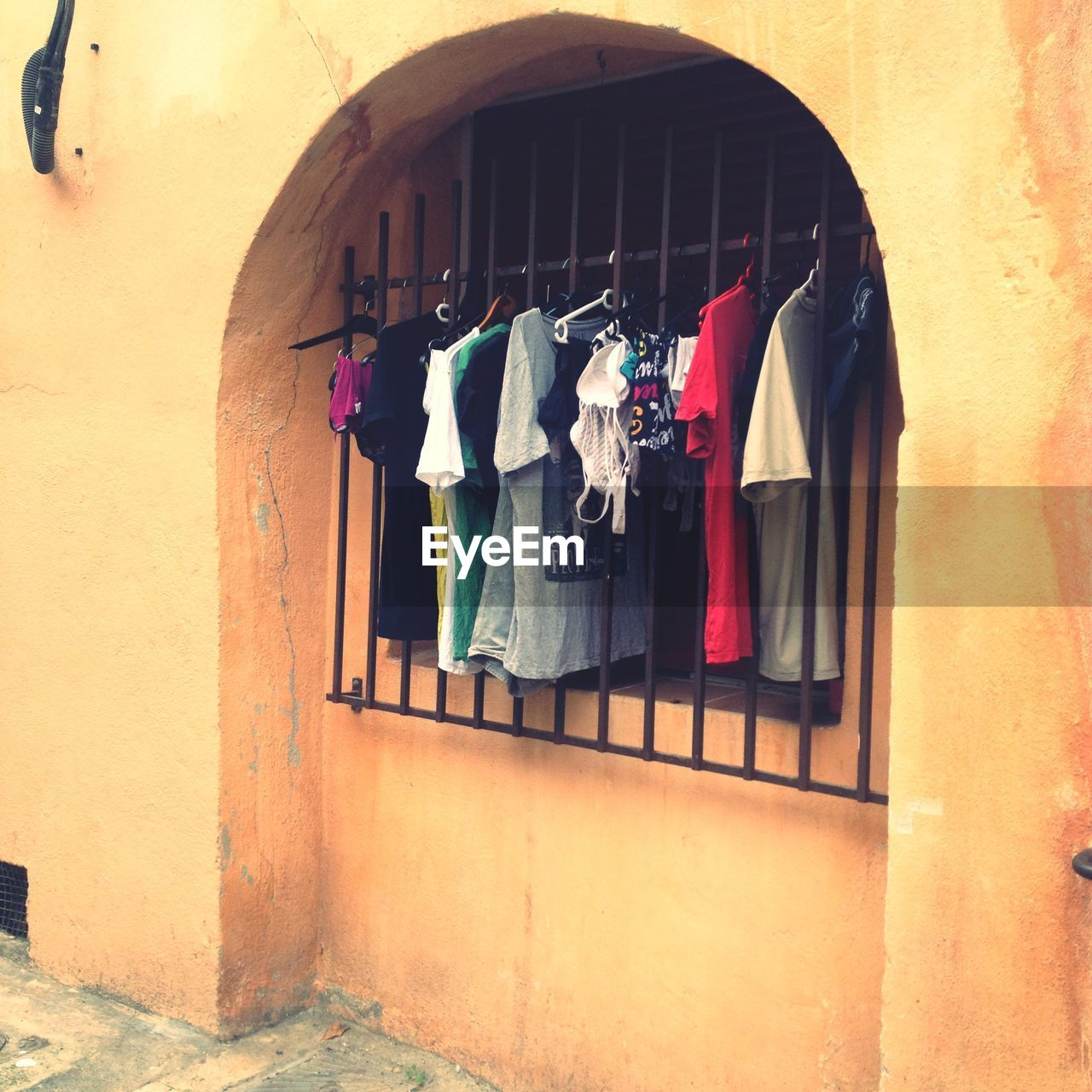 hanging, drying, clothesline, clothing, built structure, architecture, building exterior, no people, cloth, multi colored, day, outdoors