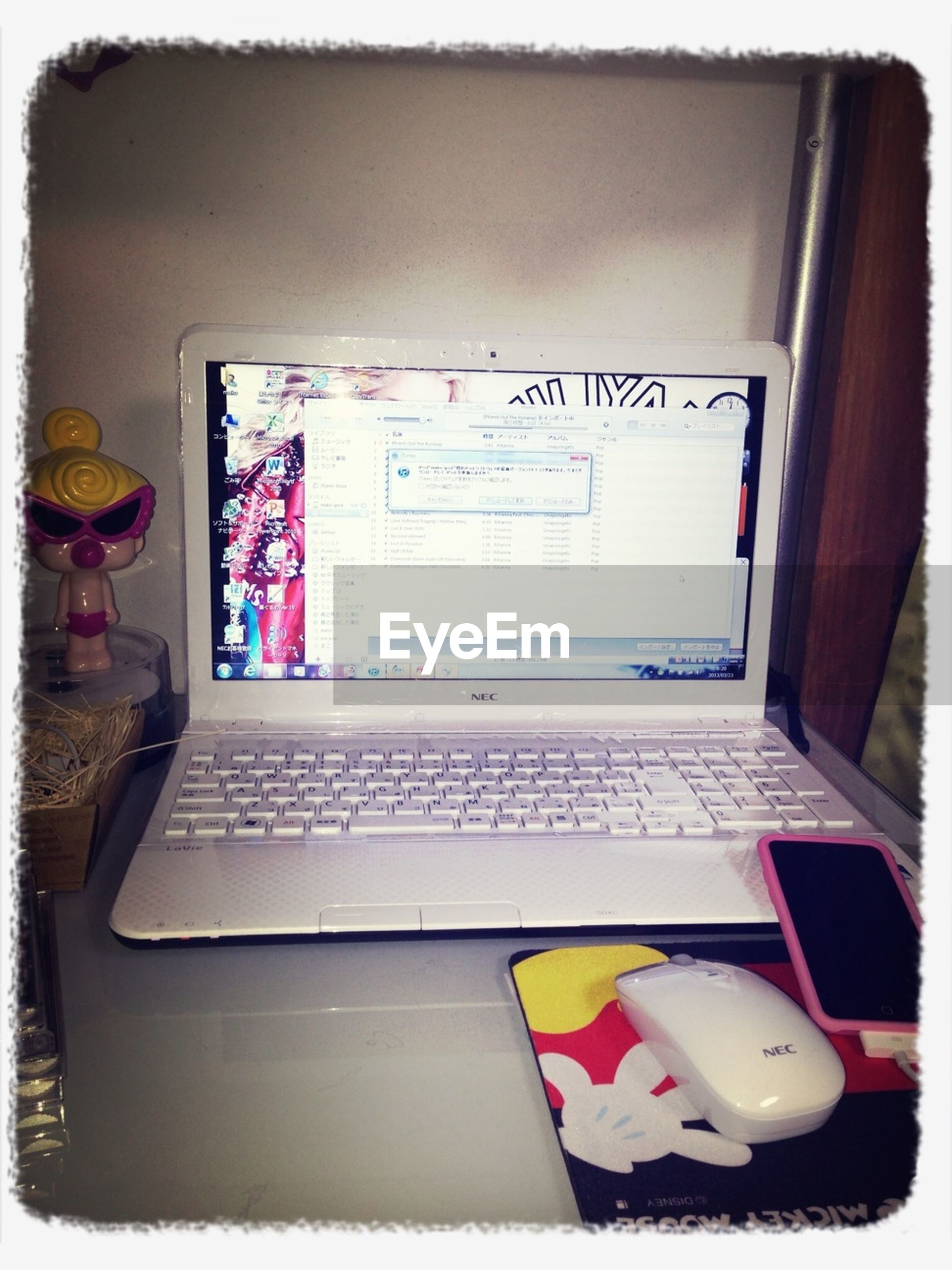 indoors, transfer print, book, communication, text, western script, table, auto post production filter, paper, education, still life, close-up, pen, document, high angle view, open, technology, no people, laptop, wireless technology