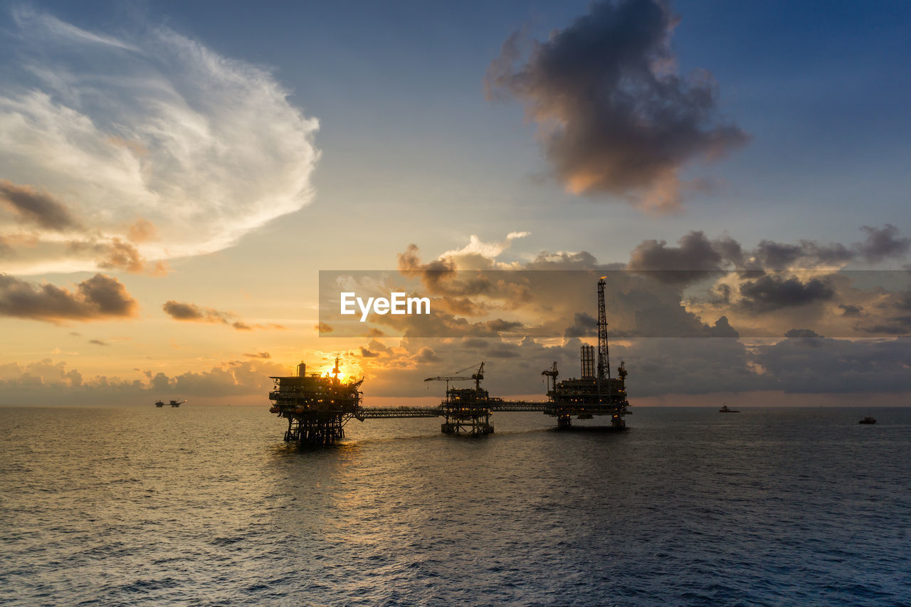 sky, cloud - sky, sea, water, industry, sunset, nautical vessel, transportation, waterfront, oil industry, nature, no people, offshore platform, mode of transportation, beauty in nature, freight transportation, fuel and power generation, scenics - nature, business, outdoors, horizon over water