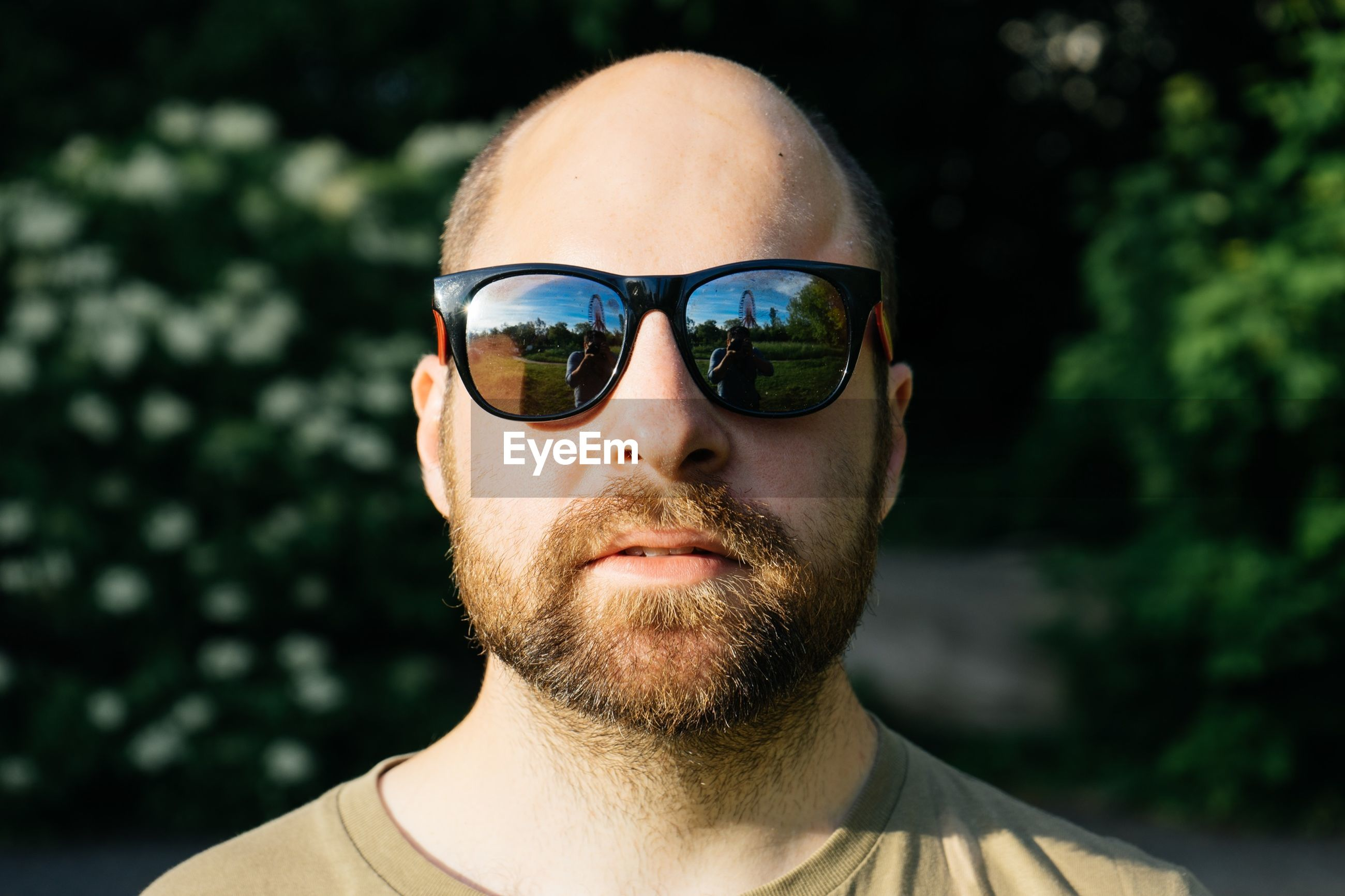 Close-up portrait of mid adult man wearing sunglasses