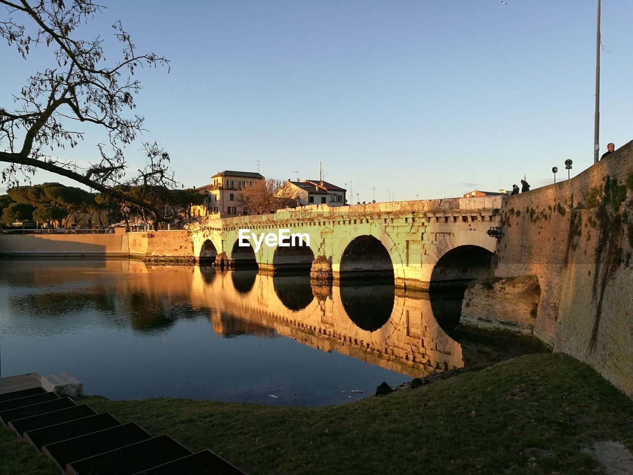 architecture, built structure, water, sky, bridge, nature, bridge - man made structure, plant, connection, river, tree, arch, clear sky, arch bridge, day, building exterior, no people, transportation, reflection, outdoors