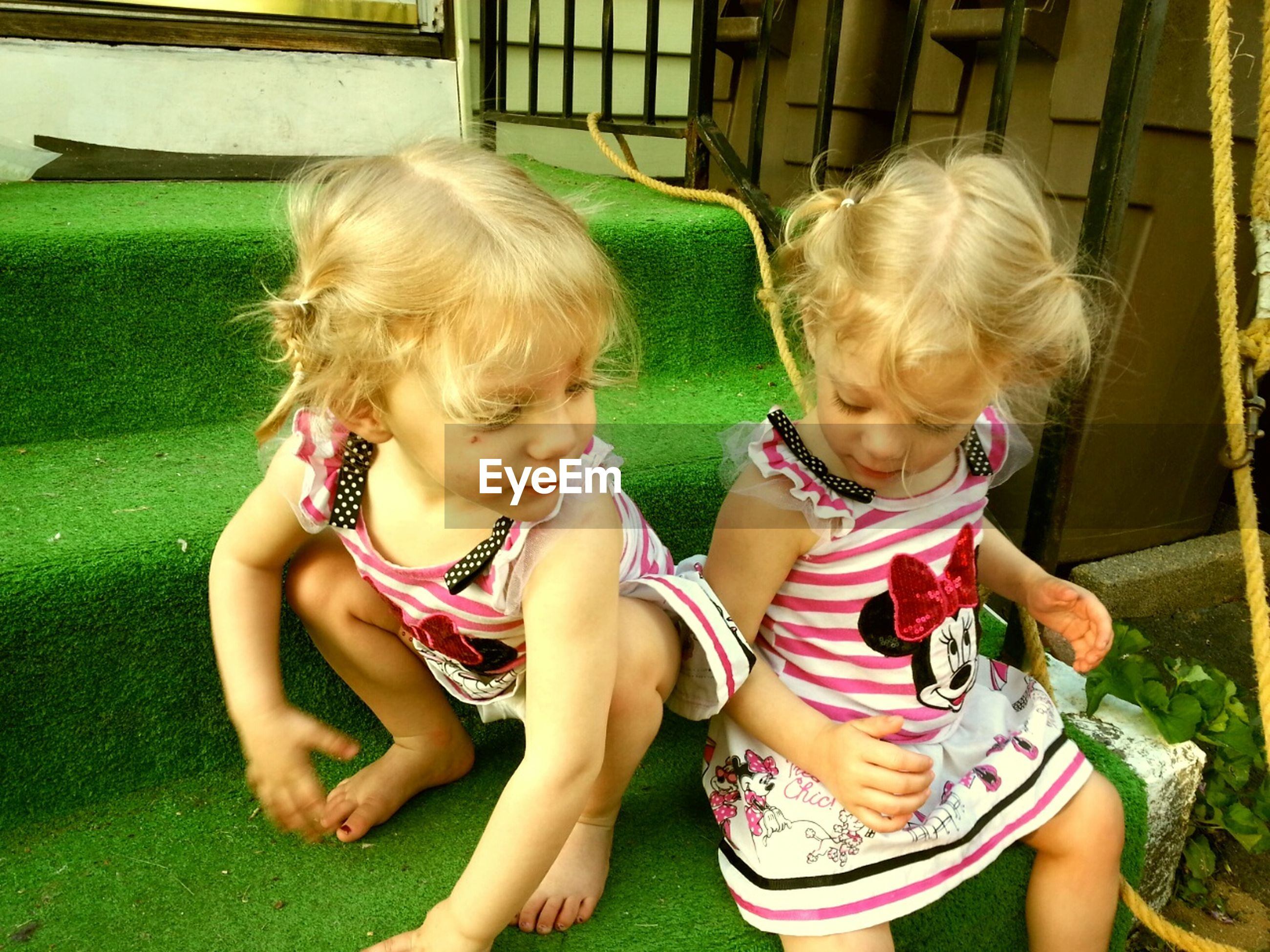 childhood, elementary age, girls, person, cute, innocence, lifestyles, leisure activity, boys, casual clothing, togetherness, bonding, preschool age, playful, playing, sitting, love