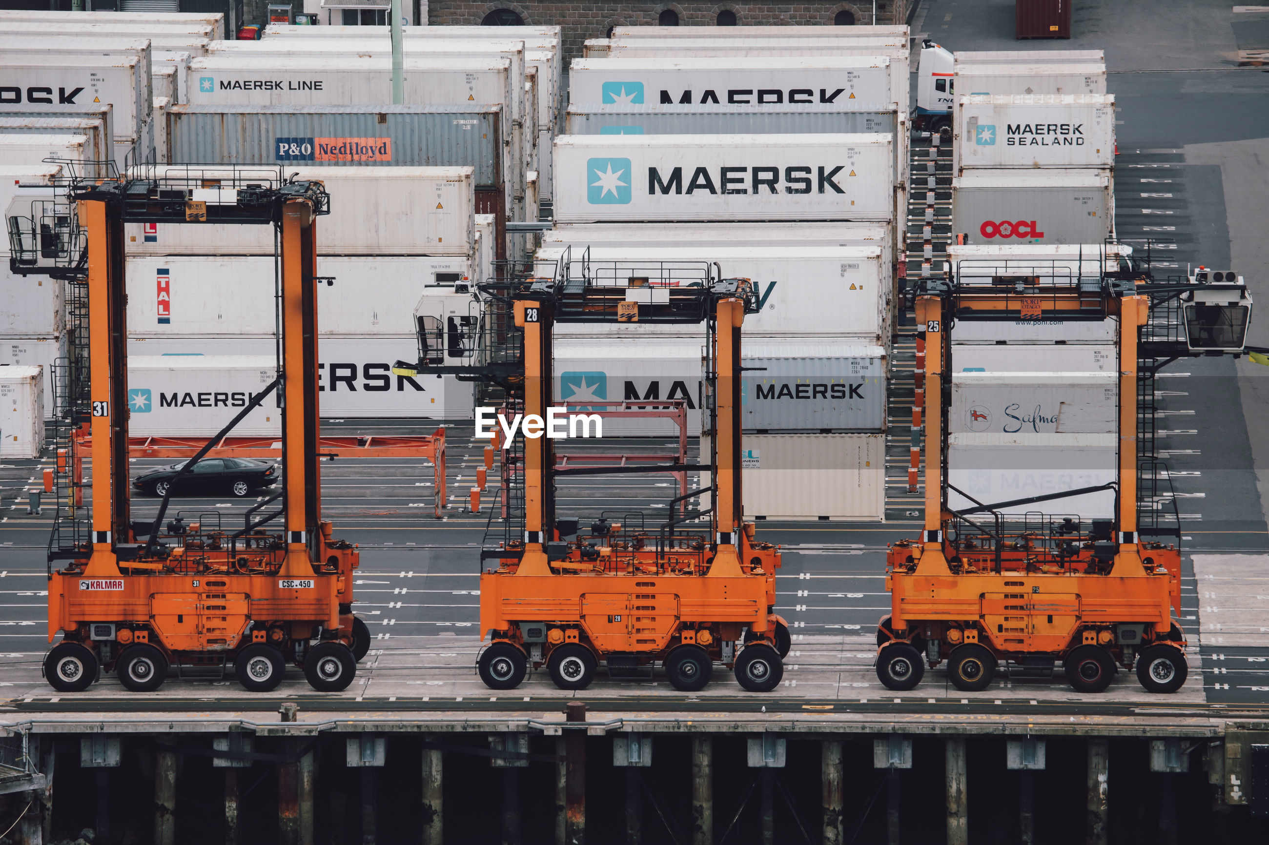 High angle view of forklift with containers at harbor