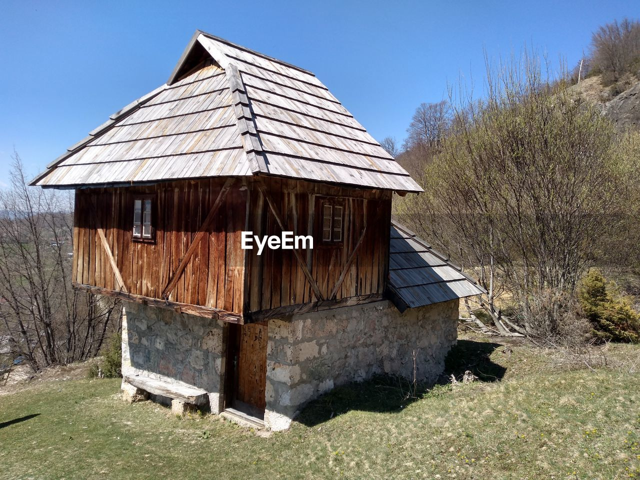 architecture, built structure, house, nature, plant, building exterior, land, sky, no people, field, day, wood - material, building, agricultural building, tree, barn, roof, clear sky, landscape, hut, outdoors, cottage, cabin