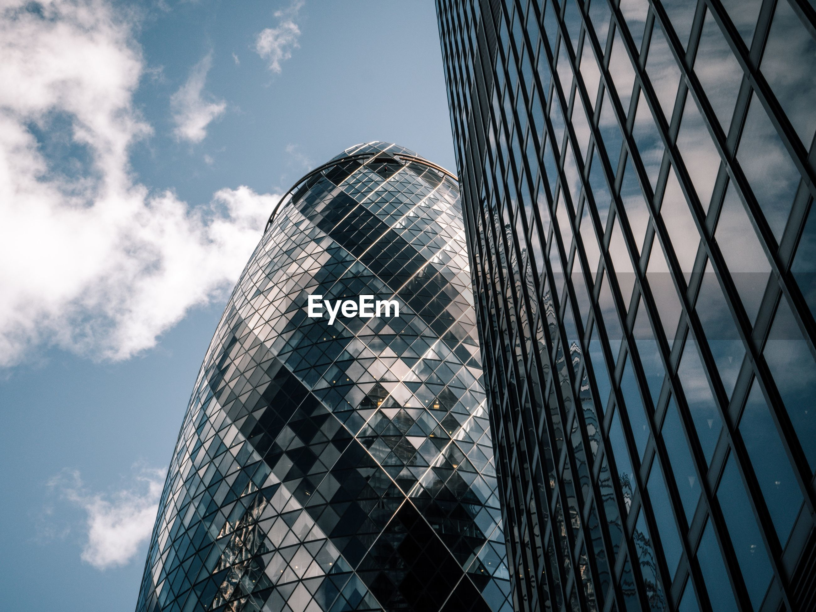 Low angle view of 30 st mary axe against sky in city