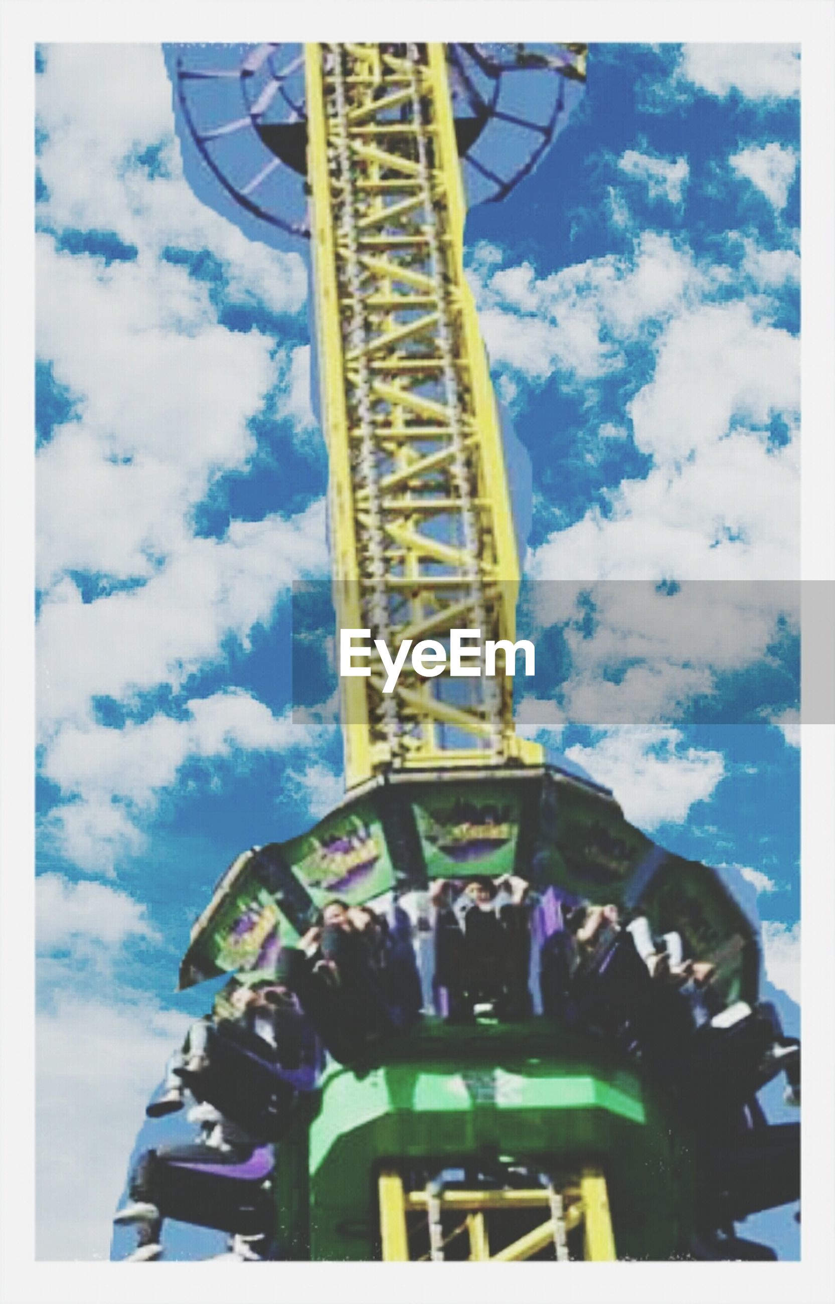 transfer print, sky, auto post production filter, low angle view, cloud - sky, metal, cloud, amusement park, cloudy, metallic, built structure, day, outdoors, arts culture and entertainment, architecture, amusement park ride, blue, tall - high, travel, no people