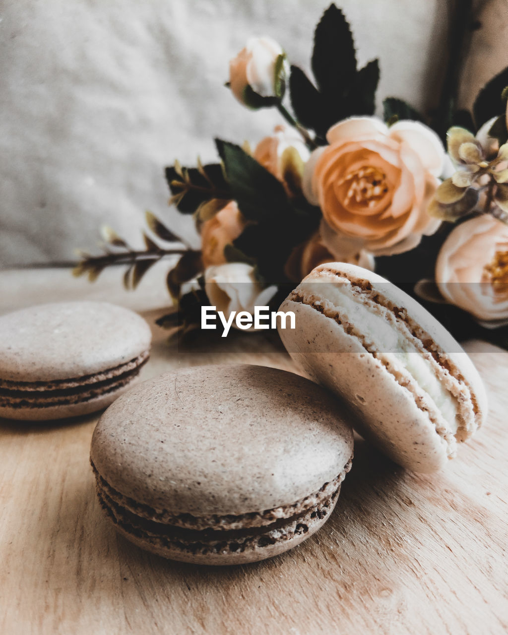 table, freshness, still life, food and drink, close-up, indoors, food, no people, focus on foreground, wood - material, plant, flower, wellbeing, group of objects, brown, indulgence, flowering plant, sweet food, white color, high angle view, macaroon, temptation