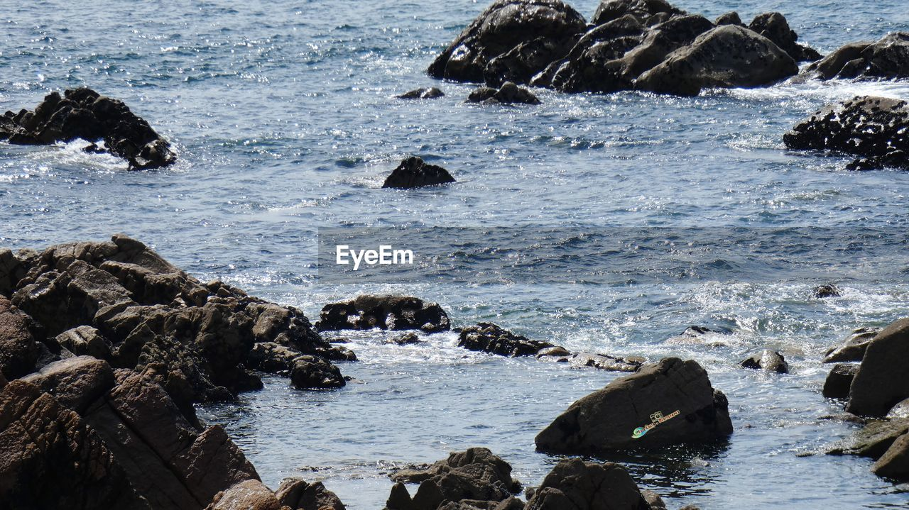 water, rock, rock - object, sea, solid, beauty in nature, motion, day, nature, no people, wave, land, beach, scenics - nature, outdoors, rock formation, waterfront, sport, aquatic sport, flowing water, breaking, marine