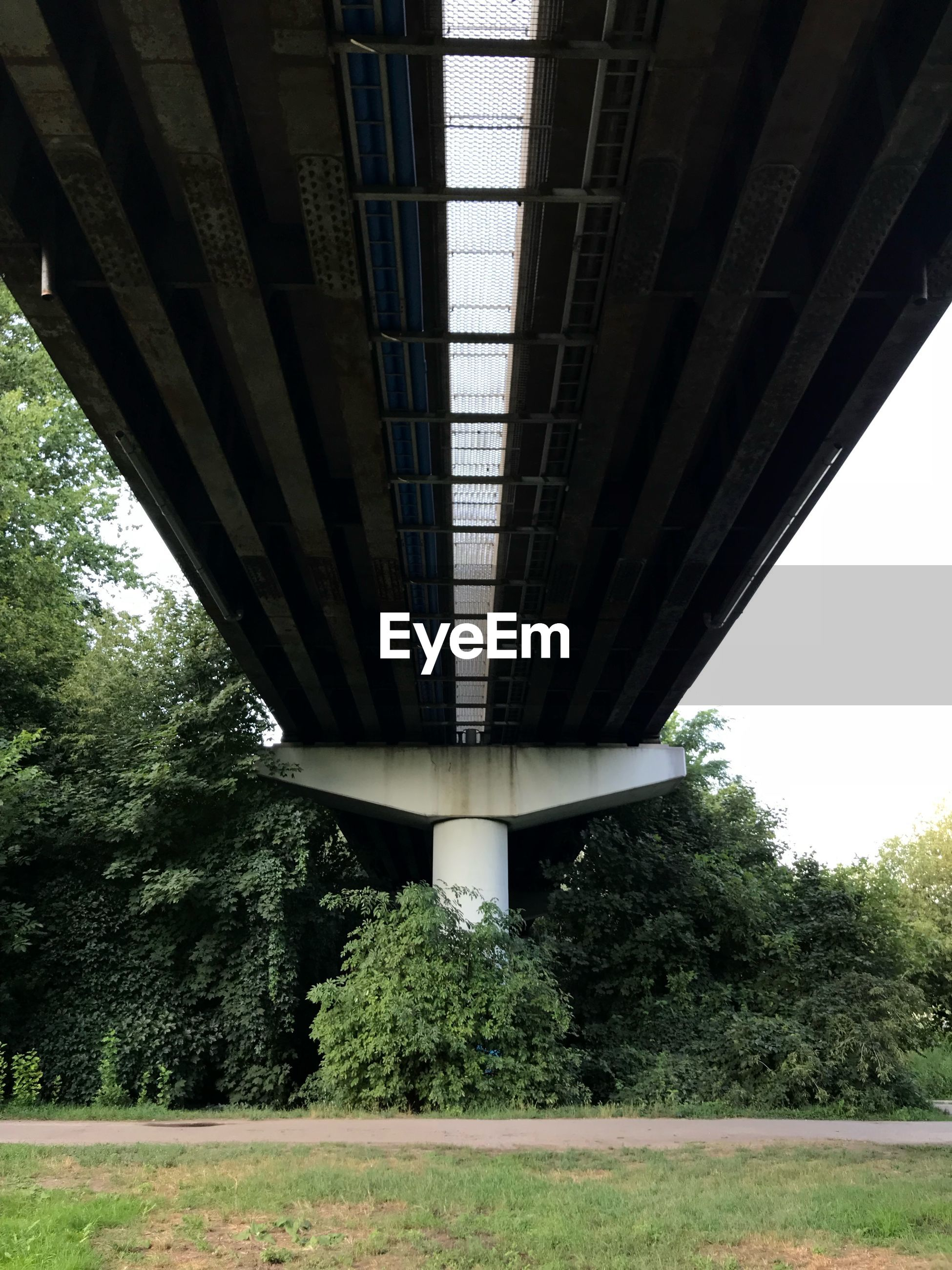 LOW ANGLE VIEW OF BRIDGE OVER ROAD