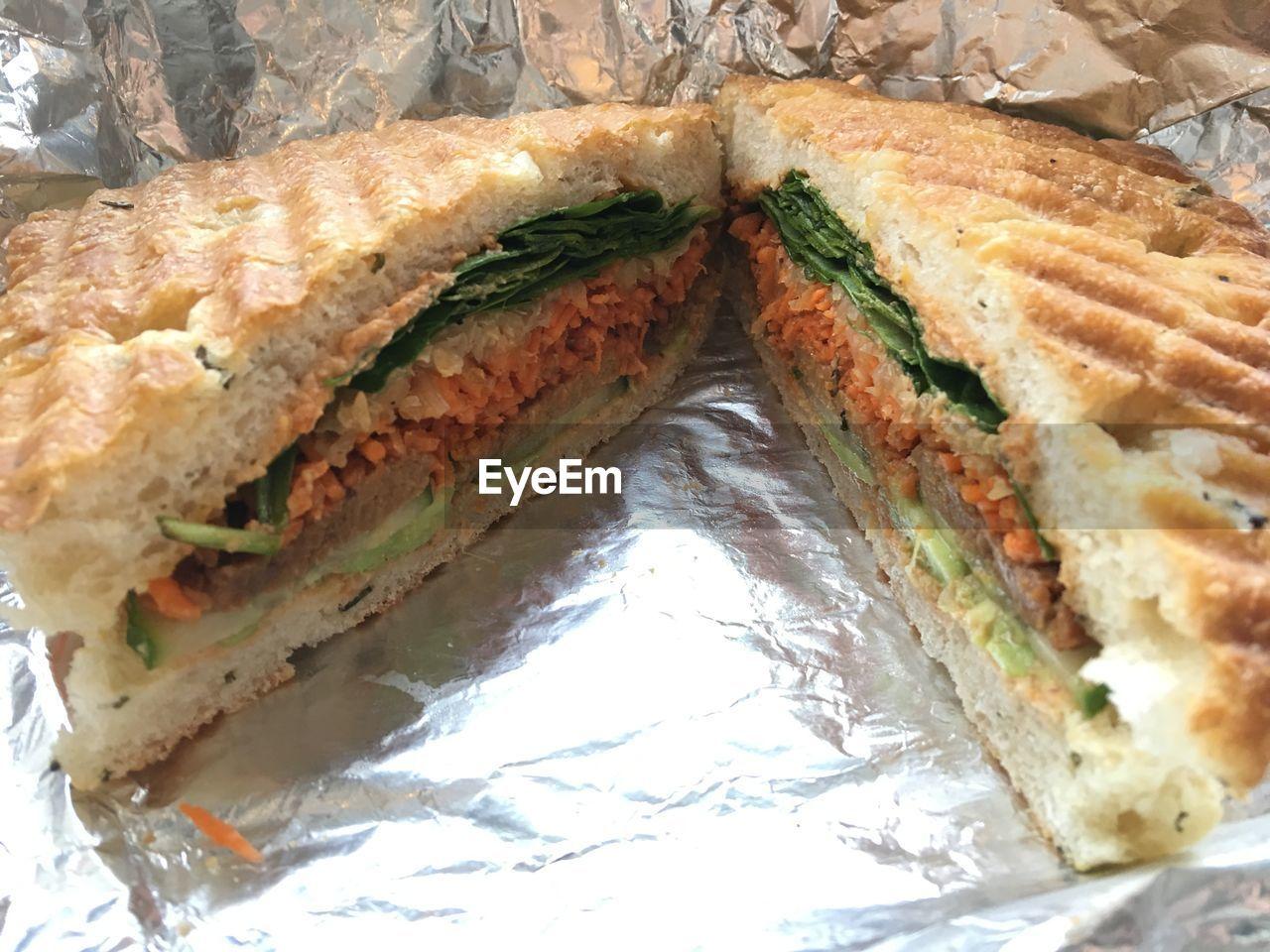 Close-Up Of Sliced Sandwich On Foil