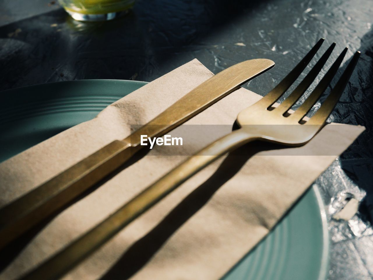 Close-up of fork and table knife on plate
