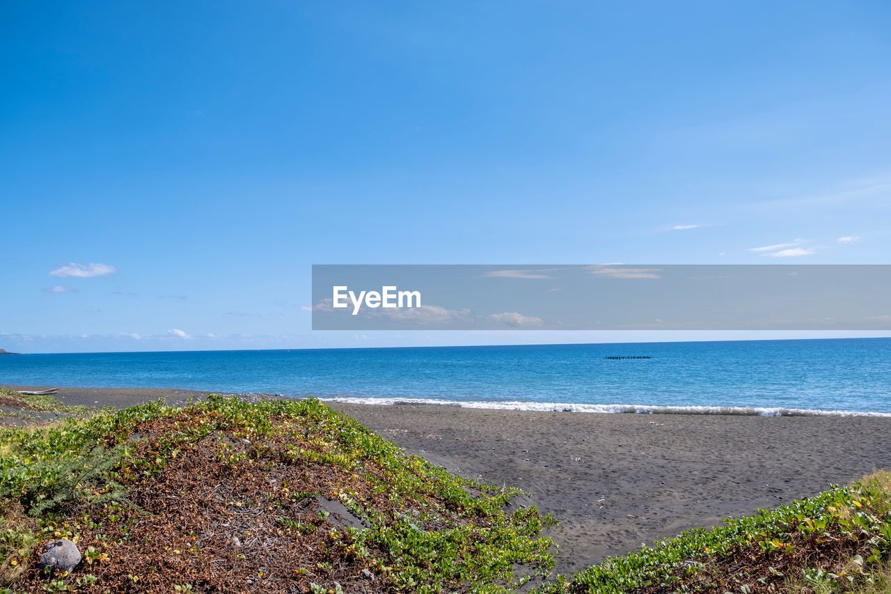 sea, water, sky, scenics - nature, horizon over water, beauty in nature, land, horizon, tranquil scene, tranquility, beach, blue, nature, plant, day, no people, idyllic, non-urban scene, cloud - sky, outdoors